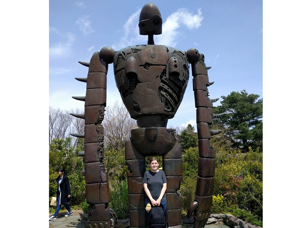 Me posing in front of a giant robot statue