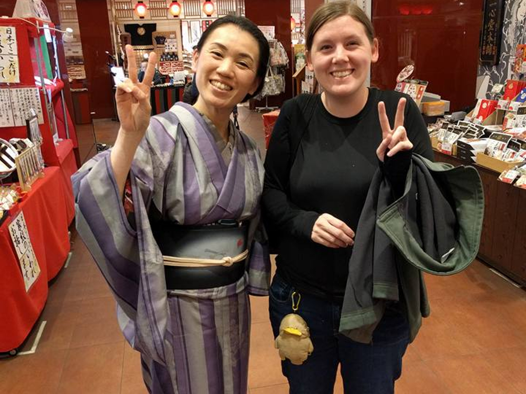 Japanese woman in a kimono posing with me